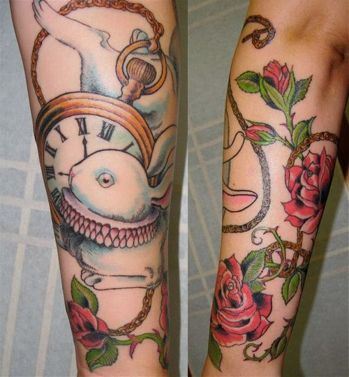 Superior multicolored forearm beautiful rabbit tattoo with flowers and clock