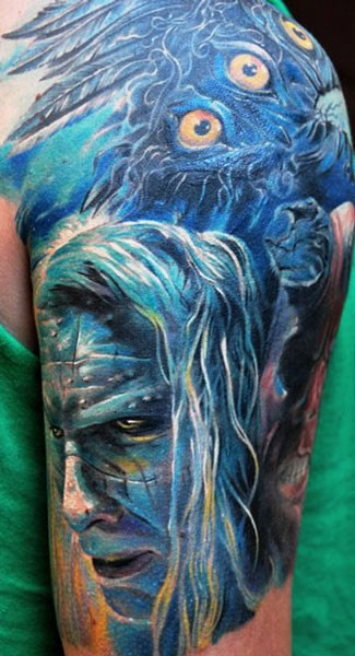 Superior multicolored shoulder tattoo of mystical man face with feather