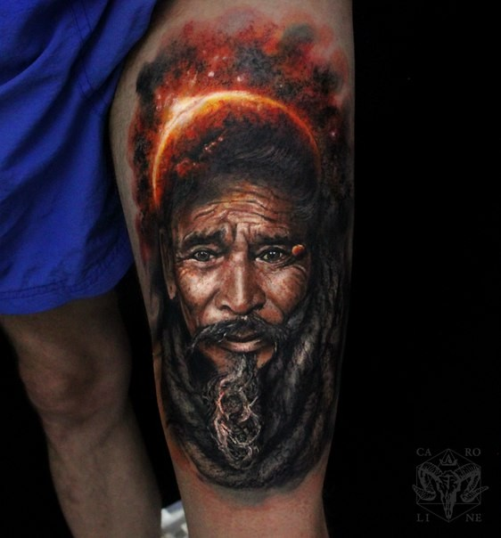 Superior multicolored thigh tattoo of fantasy man and big planet