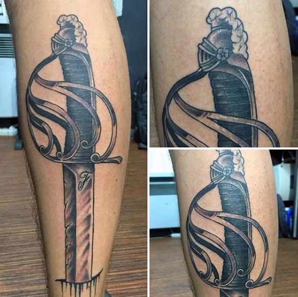 Superior painted black ink antic sword tattoo on leg