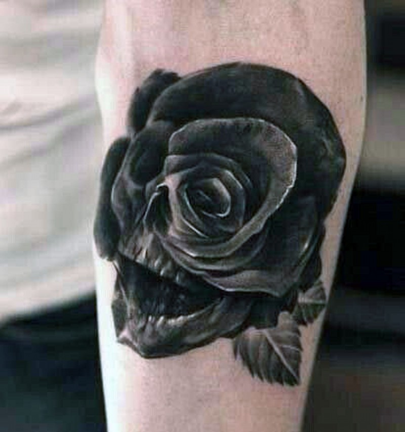 Superior painted black ink detailed rose stylized with skull tattoo on arm