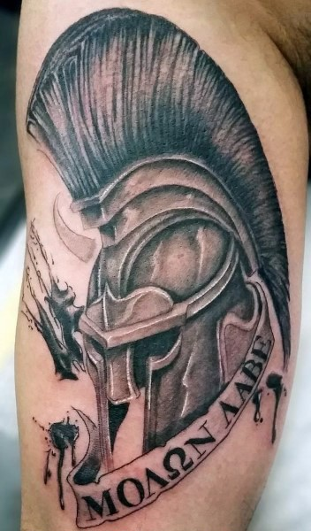 Superior painted detailed black ink Spartan warrior with lettering tattoo on arm