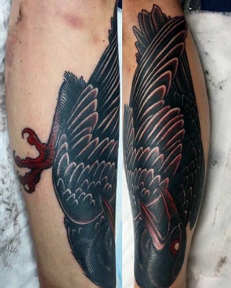 Superior painted multicolored mystical crow tattoo on leg