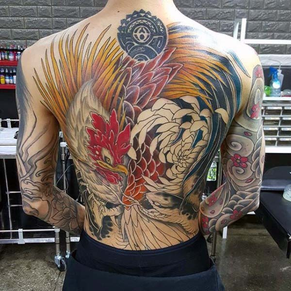 Superior painted very detailed colorful cock fighting the snake tattoo on whole back