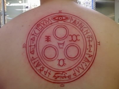 Superior red colored massive upper back tattoo of tribal wall painting