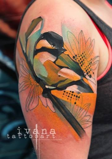 Superior watercolor like colored shoulder tattoo of bird on tree branch