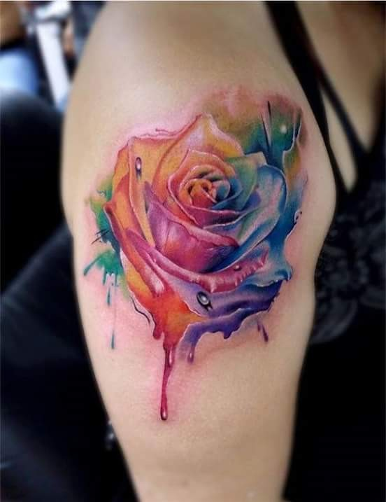 Superior watercolor style colored shoulder tattoo of beautiful rose