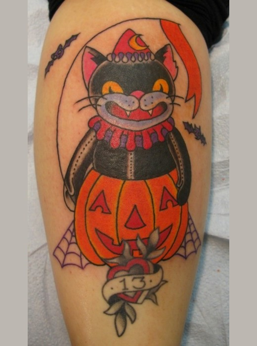 Superstitious black cat in Halloween pumpkin costume and number 13 colored leg tattoo