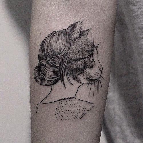 Surrealism dot style forearm tattoo of half woman half cat portrait