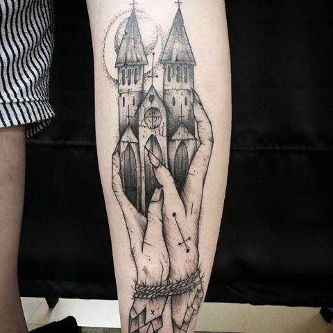 Surrealism style black ink arm tattoo of hands holding castle