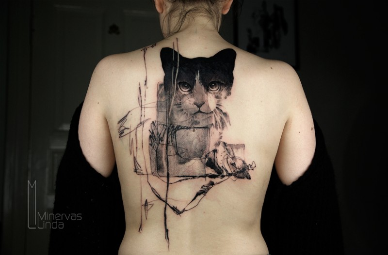 Surrealism style black ink back tattoo of cat face with ornaments