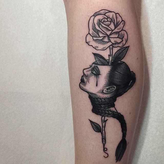 Surrealism style black ink colored leg tattoo of woman head with rose flower