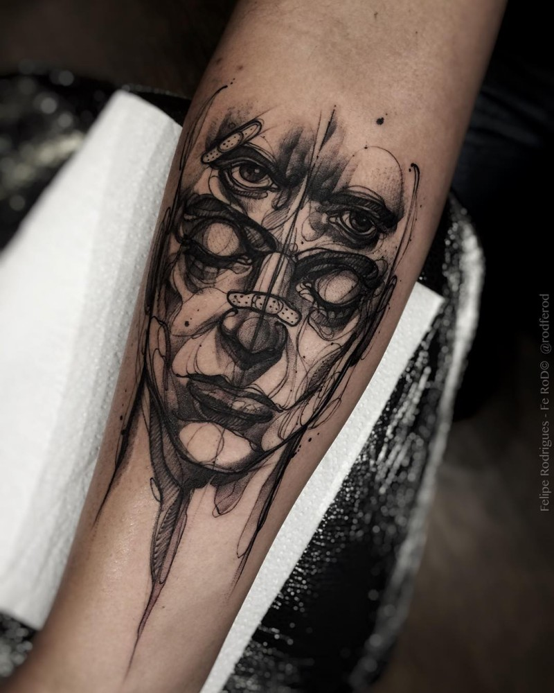 Surrealism style black ink forearm tattoo of mystical mask with bandage