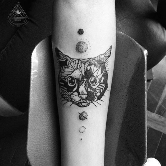 Surrealism style black ink forearm tattoo of stone like cat with planets