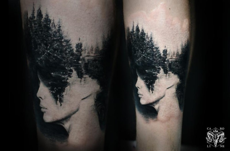 Surrealism style black ink leg tattoo of woman face and forest