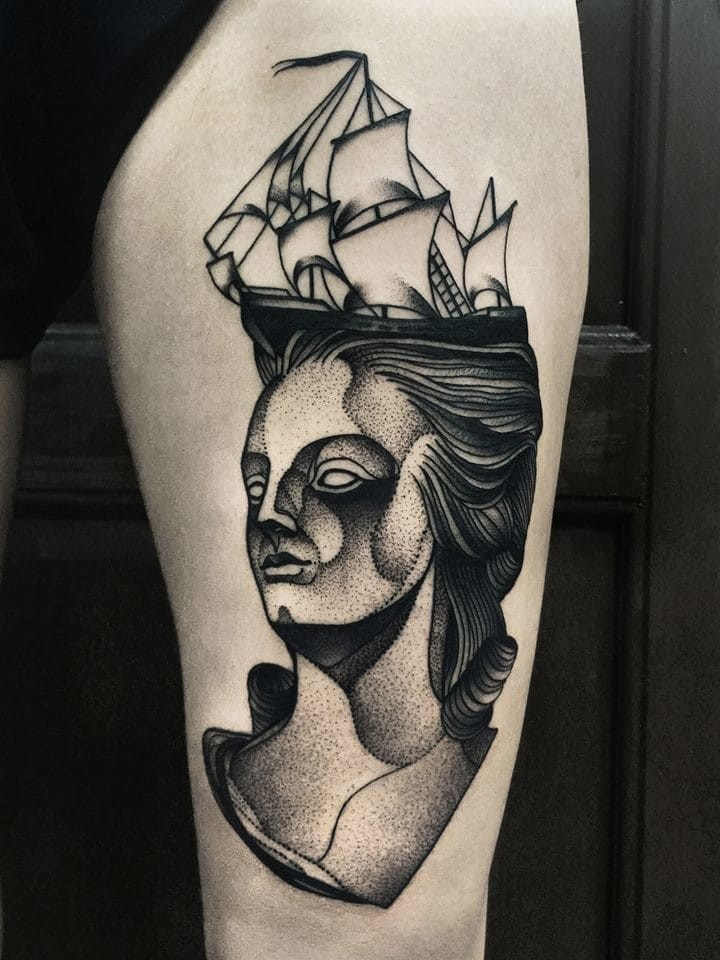 Surrealism style black ink painted by Michele Zingales thigh tattoo of woman face with sailing ship on head