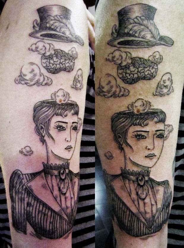 Surrealism style black ink shoulder tattoo of woman with human brains and hat