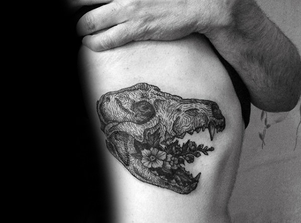 Surrealism style black ink side tattoo of animal skull with flowers