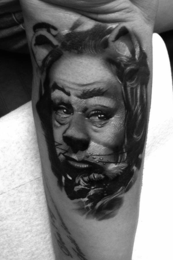 Surrealism style black ink tattoo of fantasy cat man