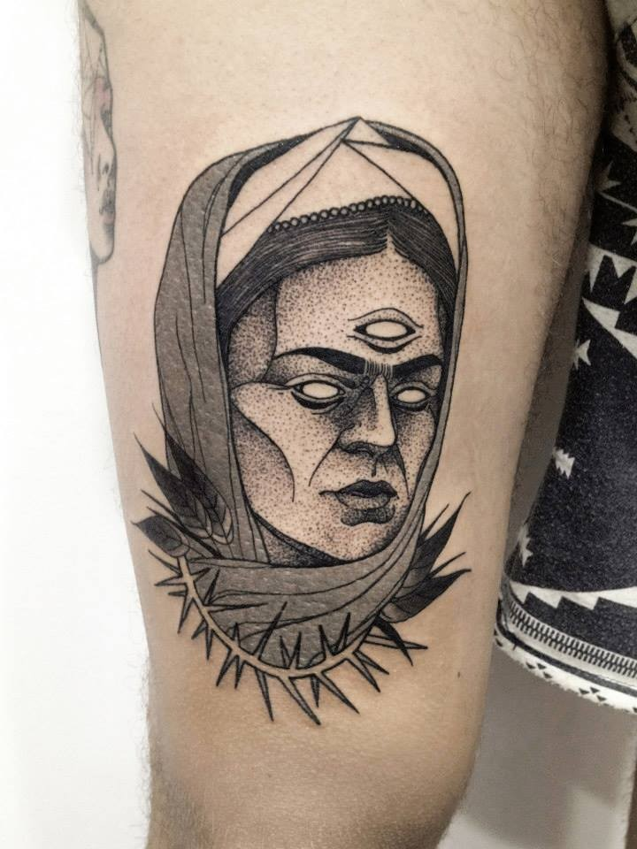 Surrealism style black ink thigh tattoo of demonic woman face with vine