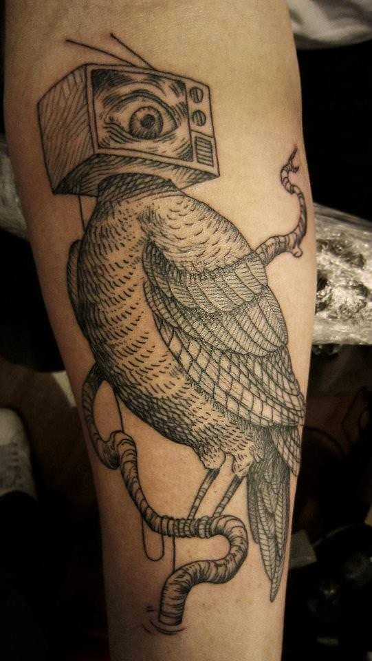 Surrealism style black ink thigh tattoo of bird with TV instead of head