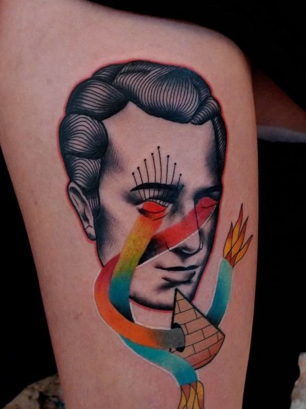 Surrealism style colored arm tattoo of man face with pyramids