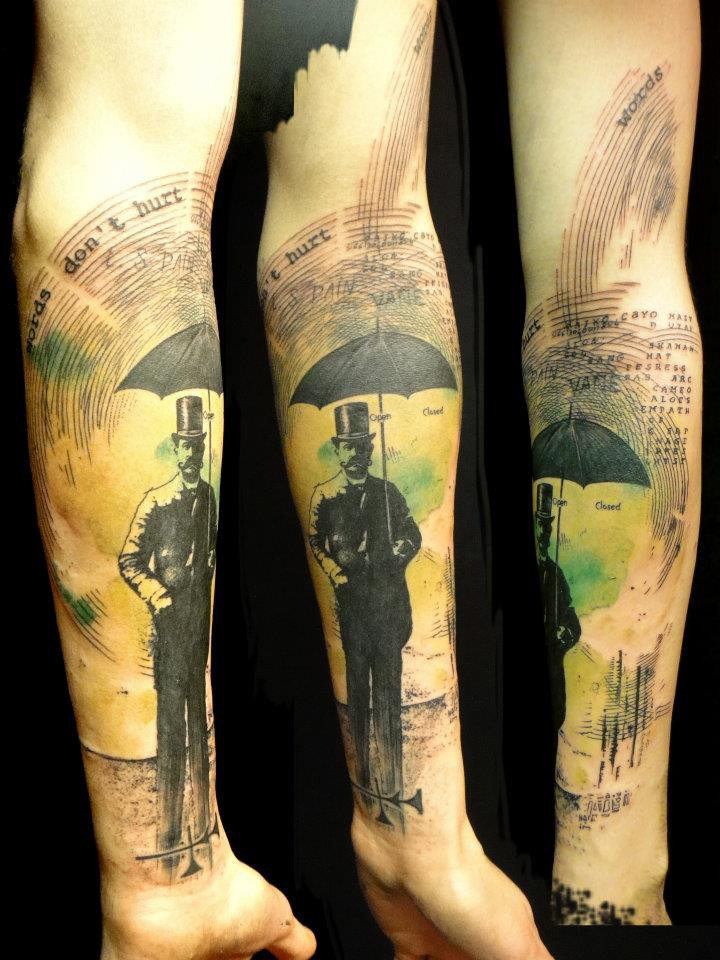 Surrealism style colored arm tattoo of man with umbrella and lettering