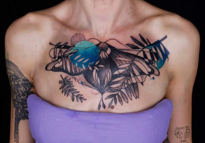 Surrealism style colored collarbone tattoo of strange butterfly with leaves