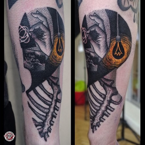 Surrealism style colored forearm tattoo of bulb with skeleton