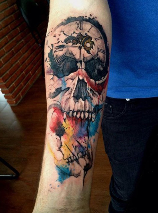 Surrealism style colored forearm tattoo of human skull with clock