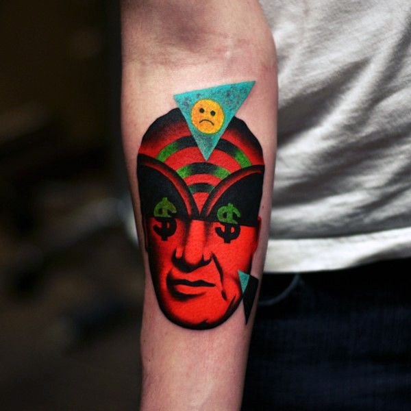 Surrealism style colored forearm tattoo of human face with various symbols and smiley face