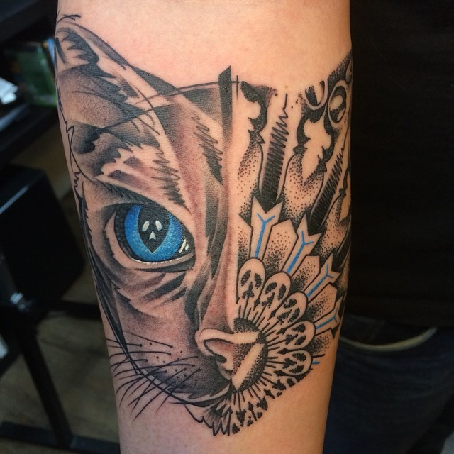 Surrealism style colored forearm tattoo of half cat half