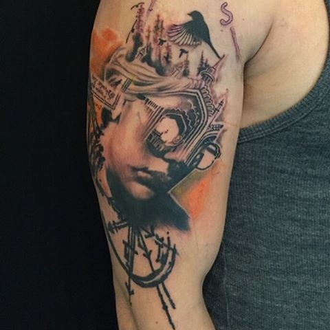 Surrealism style colored shoulder tattoo of human face stylized with medieval cathedral and clock
