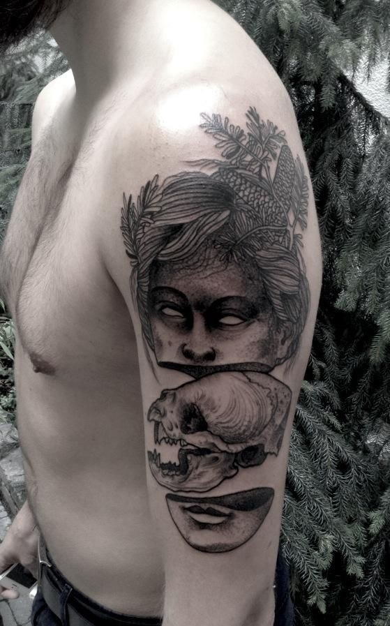 Surrealism style colored shoulder tattoo of creepy woman face with cat skull