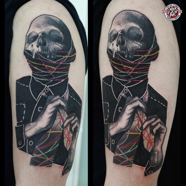 Surrealism style colored shoulder tattoo of man portrait with skull