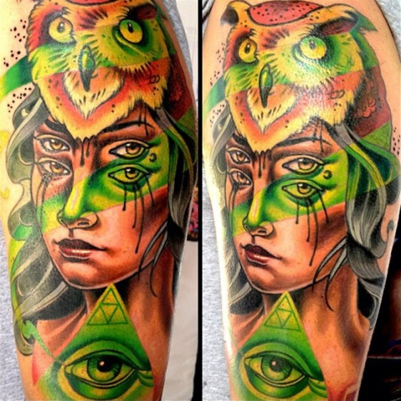 Surrealism style colored shoulder tattoo of mystical woman with owl helmet