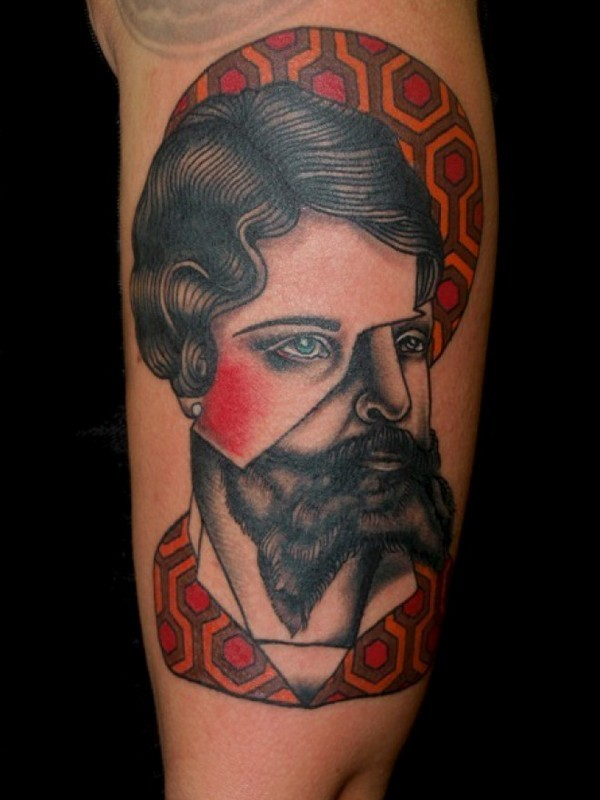 Surrealism style colored shoulder tattoo of half man half woman portrait