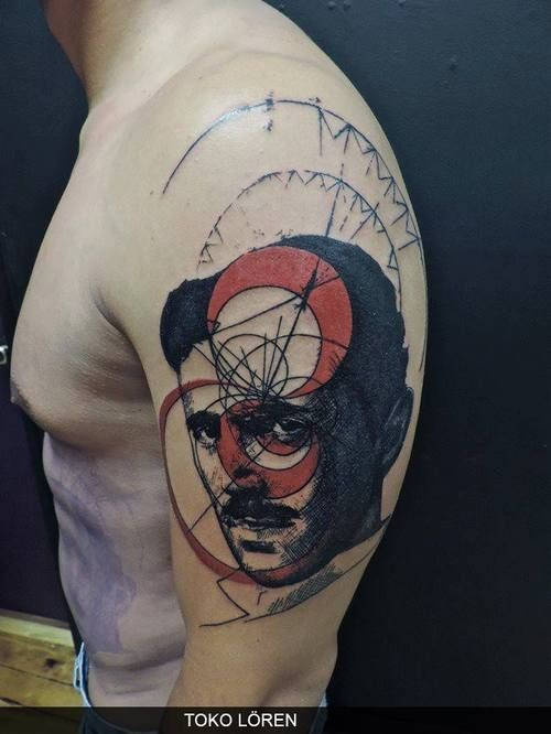 Surrealism style colored shoulder tattoo of man portrait