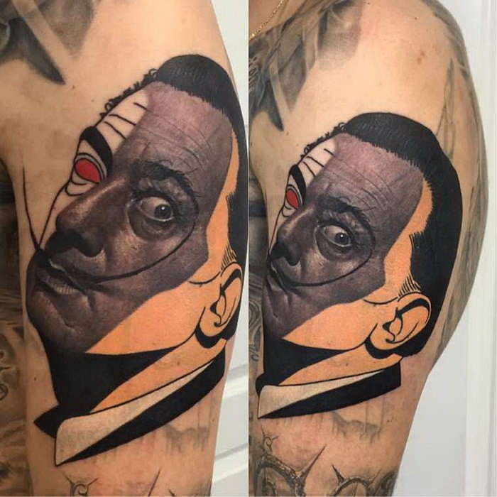 Surrealism style colored shoulder tattoo of of funny man portrait