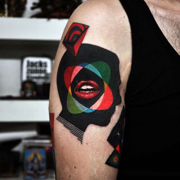 Surrealism style colored shoulder tattoo of various ornaments and woman leaps