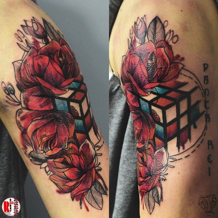 Surrealism style colored upper arm tattoo of Rubik cube with flowers