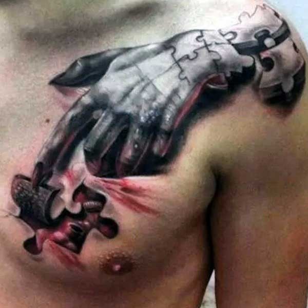Surrealism style colroed demonic hand tattoo on chest and shoulder stylized with puzzle