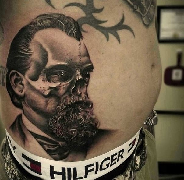 Surrealism style detailed belly tattoo of man face stylized with skull
