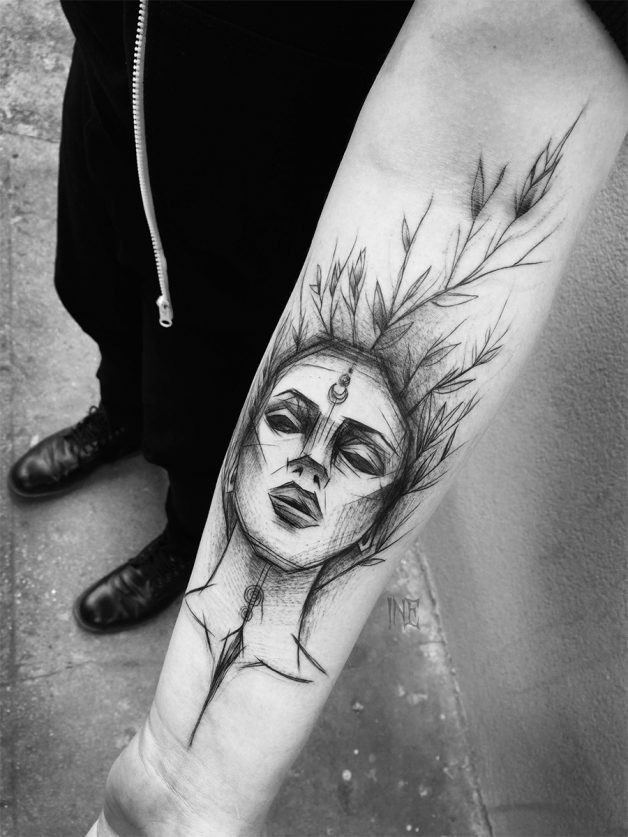 Surrealism style painted by Inez Janiak forearm tattoo of woman with leaves
