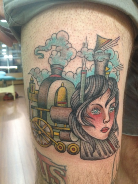 Surrealistic painted colored thigh tattoo of train with woman head