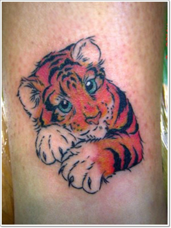 Sweet and cute little colored cartoon baby tiger tattoo on for Cartoon baby tattoos