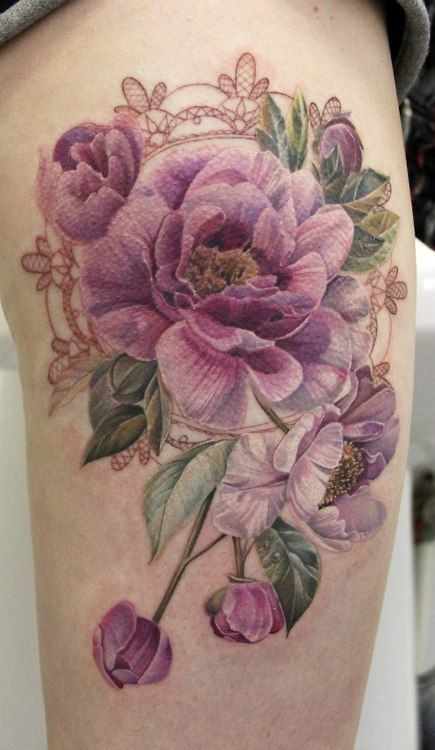 Sweet colored big realistic flowers tattoo on thigh