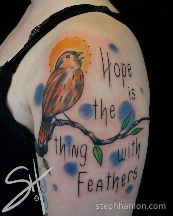 Sweet colored shoulder tattoo of bird on tree branch and lettering