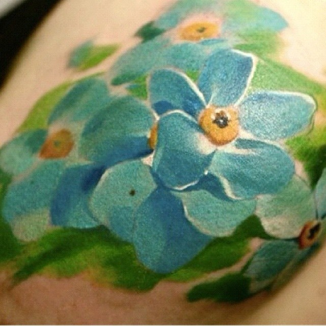Sweet illustrative style colored shoulder tattoo of flowers