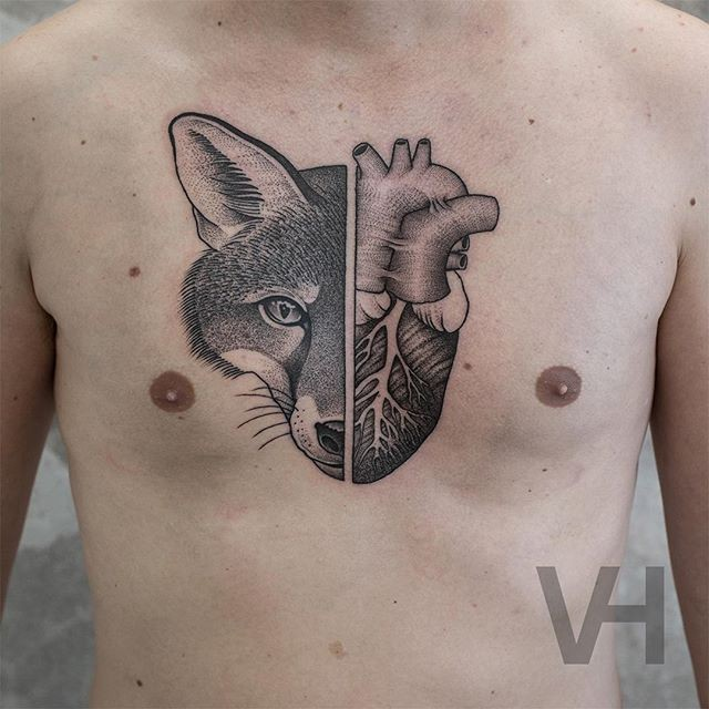 Sweet looking black ink chest tattoo of split fox with human heart by Valentin Hirsch